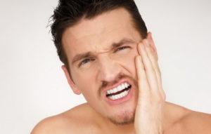 боль в челюсти возле уха и лечение