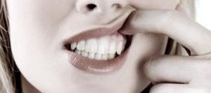 Почему шатаются зубы