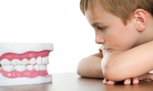 Причины появления скрежета зубами во сне у ребенка и лечение
